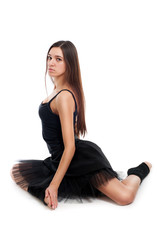 female ballet dancer in black dress with beautiful healthy brown