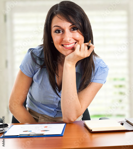 Smiling businesswoman at her office desk