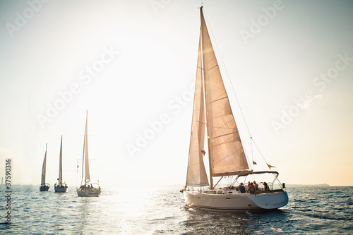 Leinwanddruck Bild Sailing ship yachts with white sails