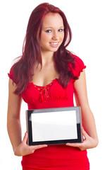 Frau hält Tablet Computer vor dem Bauch