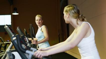 Women talking in fitness center