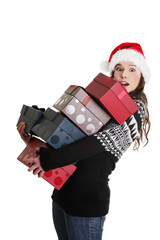 Woman in santa hat holding christmas boxes,