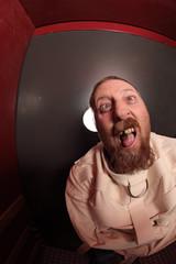 Insane man in a straitjacket