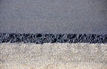 Repair of the road. Freshly asphalt