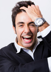 Portrait of attractive young man laughing