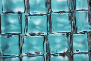 Ice cubes on blue closeup