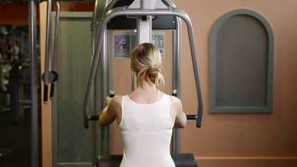 Woman working out in fitness center
