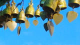 wind chimes on blue sky background poster