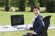 Businessman sitting outdoors at desk