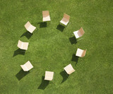 Chairs in circle formation on grass