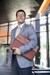 Businessman holding briefcase in office
