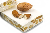 Nougat with almonds on the white