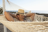 Man taking nap in hammock