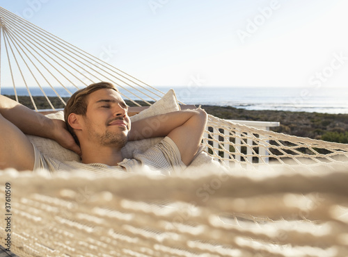 Man napping in hammock