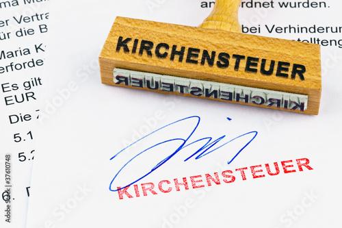 Holzstempel auf Dokument: Kirchensteuer