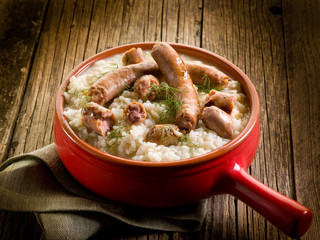 risotto with sausage over red casserole