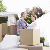 Couple standing near moving boxes