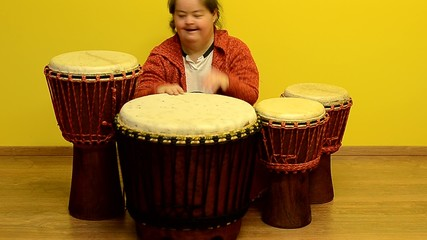 down syndrome woman play in djembe