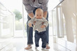 Father teaching son to walk