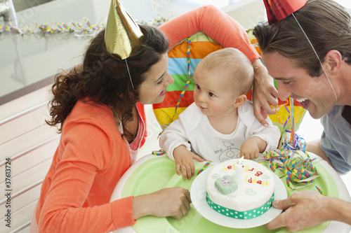 Parents celebrating baby?s first birthday