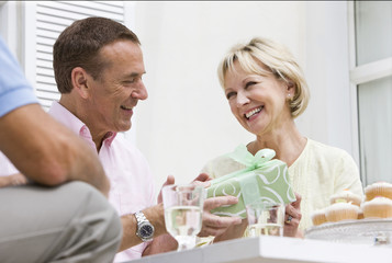 Man giving wife birthday gift