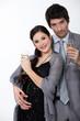 Glamorous couple drinking champagne