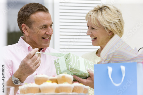 Wife giving birthday gift to husband