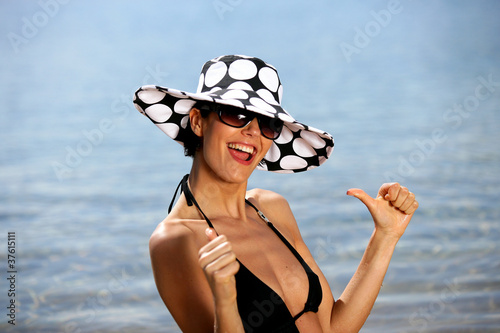 Woman at the beach giving thumb-s up
