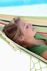 young girl resting in hammock