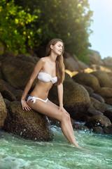 Beautiful woman in bikini on the tropical beach