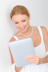 Beautiful bride using digital tablet