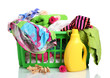 Clothes with detergent and in green plastic basket isolated