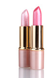 beautiful pink lipsticks isolated on white