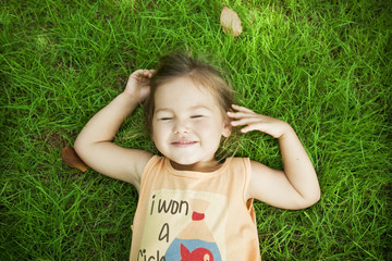 Smiling baby lying on the grass