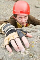 The rock-climber moves on rock upwards