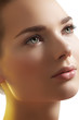 Close-up of beautiful female model face with purity health skin