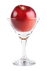 Red apple fruit in cocktail glass, isolated on white