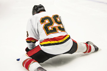 Ice Hockey Player Stretching