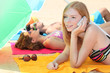 Girl sunbathing and talking on the phone