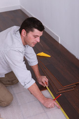 Man fitting a wooden floor