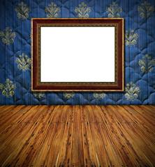 old style vintage golden frame on blue stitched textile decorate