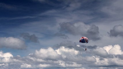 Parasailing, flying with parachute