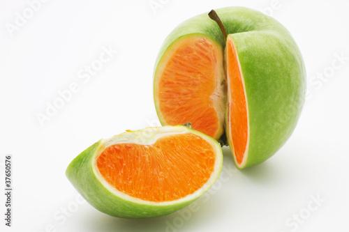 Fotobehang Vruchten Apple containing an orange