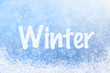 Winter Text on Blue Sparkly Sky and Snow Background