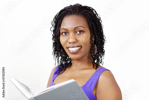 Portrait of a lovely smiling woman with book