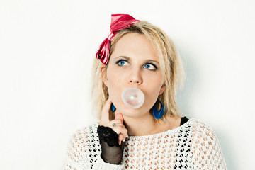 1980s girl blowing bubble gum