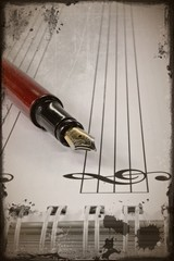 A fountain pen on sheet music in a grunge style