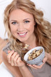 Portrait of beautiful woman eating cereals