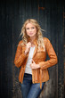 Portrait of beautiful blond woman with leather jacket