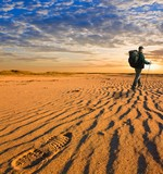 hiker walk in a hot sand desert